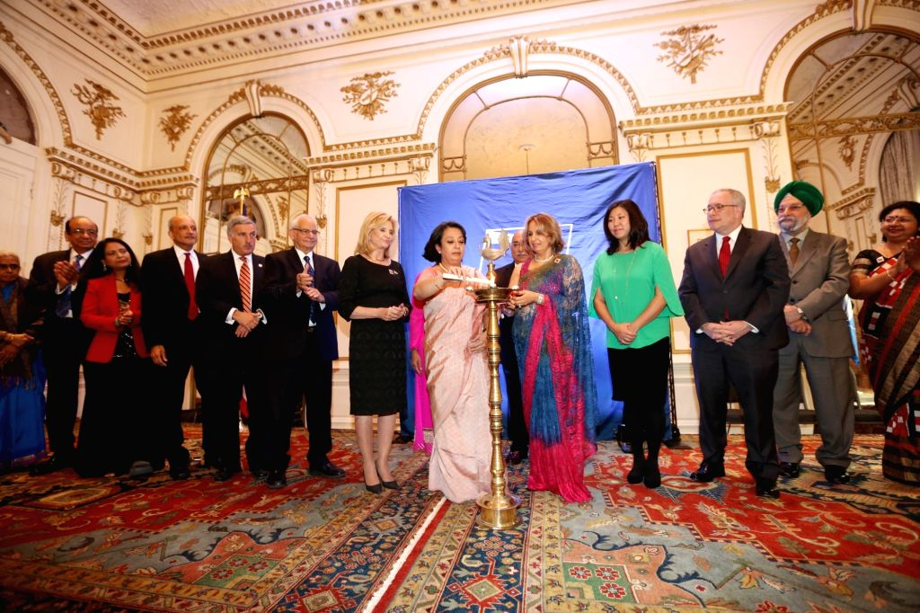 New York: United Nations Ambassador Hardeep Singh Puri, Consul General of India in New York, Riva Ganguly Das, VP Mail Entry USPS Pritha Mehra, Chair Stamp Committee Ranju Batra and others at the ... - Hardeep Singh Puri