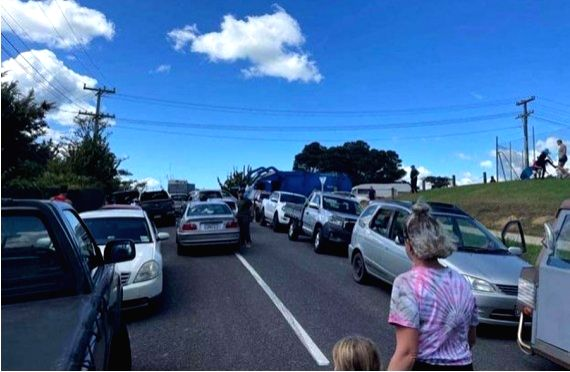 New Zealand: People gather on high ground in Whangarei, New Zealand, March 5, 2021.