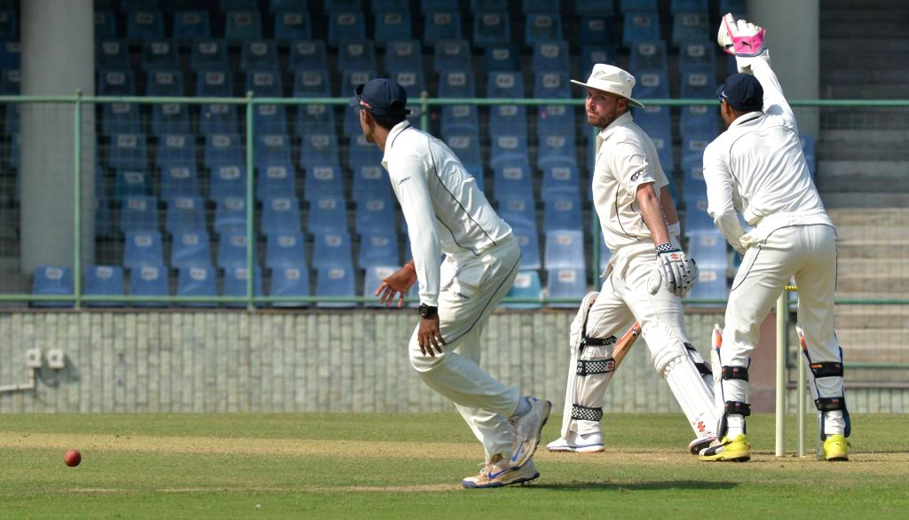 New Zealand player celebrate fall of a wicket during a practice match between New Zealand and Mumbai at Feroz Shah Kotla Stadium in New Delhi on Sept 16, 2016.