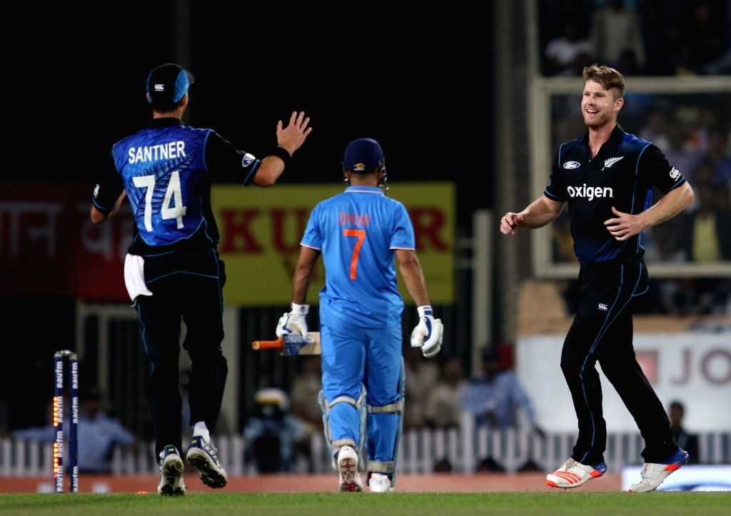New Zealand player Jimmy Neesham celebrates fall of MS Dhoni's wicket during the fourth ODI match between India and New Zealand at JSCA International Stadium Complex in Ranchi on Oct 26, 2016.