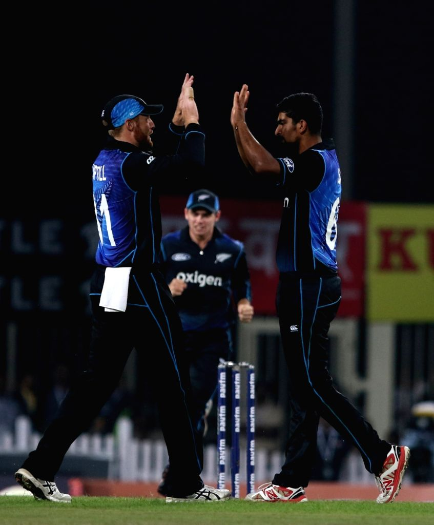 New Zealand players celebrate fall of a wicket during the fourth ODI match between India and New Zealand at JSCA International Stadium Complex in Ranchi on Oct 26, 2016.