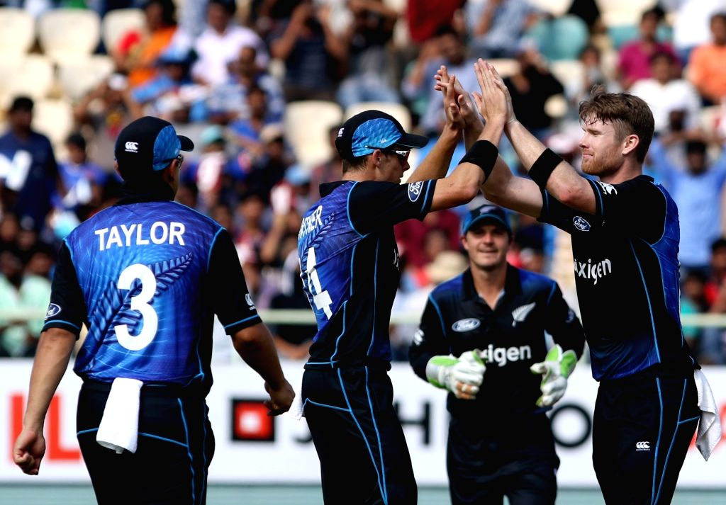 New Zealand players celebrate fall of a wicket during the fifth ODI match between India and New Zealand at Dr. Y.S. Rajasekhara Reddy ACA-VDCA Cricket Stadium in Visakhapatnam on Oct ...