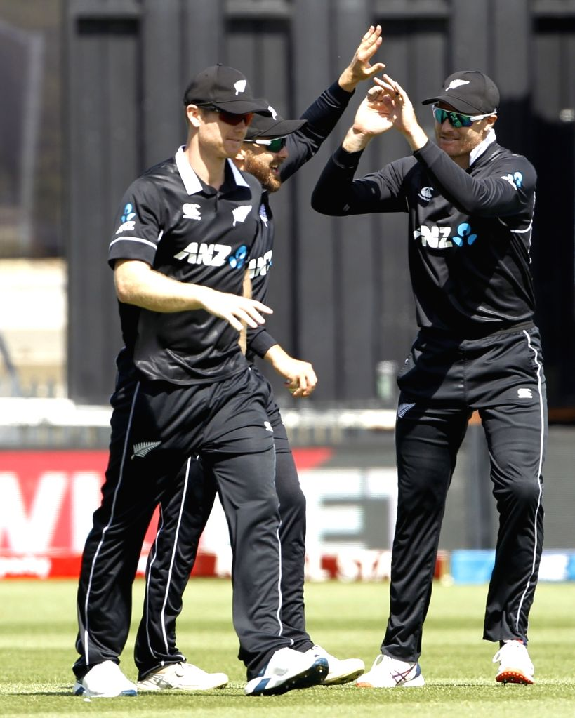 New Zealand players celebrate the wicket of  Mayank Agarwal during the 1st ODI of the three-match series between India and New Zealand at the Seddon Park in Hamilton, New Zealand on Feb 5, ...