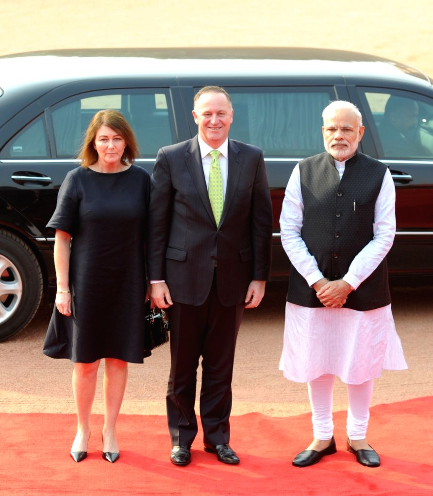 New Zealand Prime Minister John Key being received by the Prime Minister Narendra Modi, at the Ceremonial Reception organised for him at Rashtrapati Bhavan, in New Delhi on Oct 26, 2016. - John Key and Narendra Modi