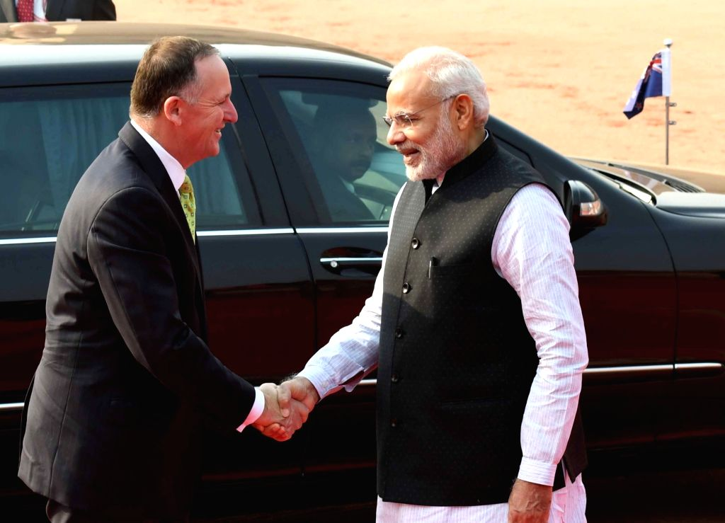 New Zealand Prime Minister John Key being received by Prime Minister Narendra Modi, at the Ceremonial Reception organised for him at Rashtrapati Bhavan, in New Delhi on Oct 26, 2016. - John Key and Narendra Modi