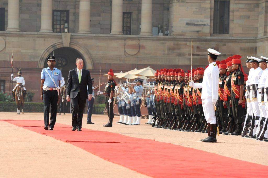New Zealand Prime Minister John Key inspects guard of honour  at the Ceremonial Reception organised for him at Rashtrapati Bhavan, in New Delhi on Oct 26, 2016. - John Key