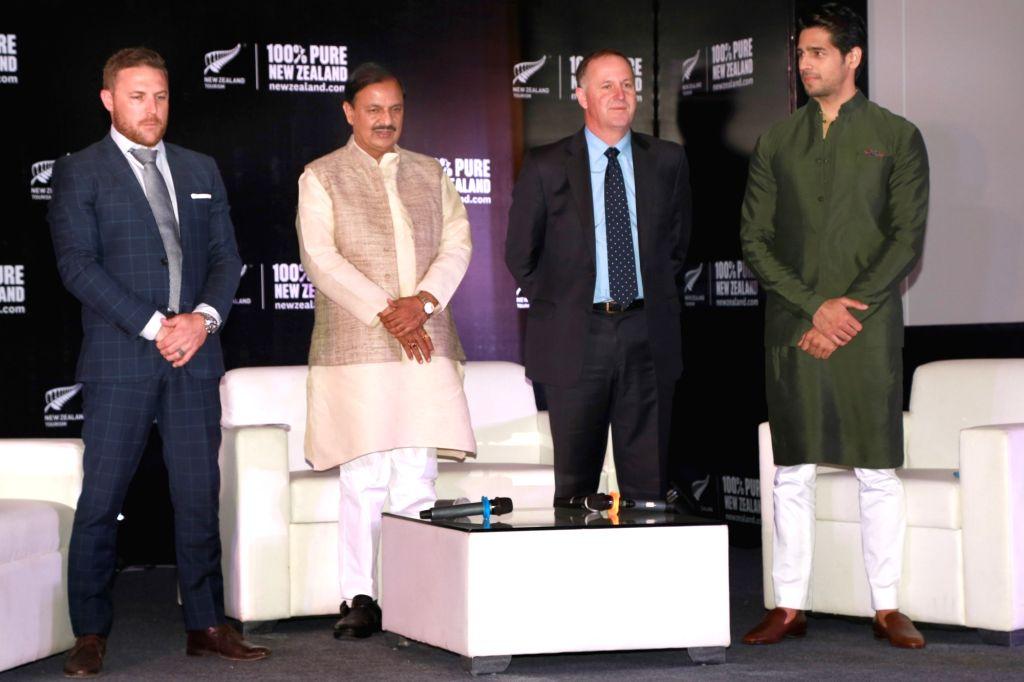 New Zealand Prime Minister John Key , Union Tourism and Culture Minister Dr Mahesh Sharma with New Zealand's Brand Ambassador Sidharth Malhotra and former cricket captain Brendon ... - John Key, Mahesh Sharma and Sidharth Malhotra