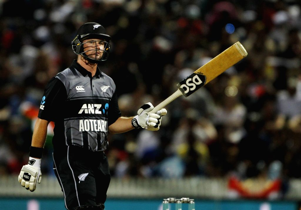 New Zealand's Colin Munro celebrates his half century during the third T20I match between India and New Zealand at Seddon Park in Hamilton, New Zealand on Feb 10, 2019.