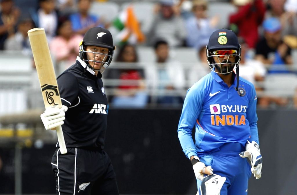New Zealand's cricketer Martin Guptill raise his bat after completing fifty during the 2nd ODI of the three-match series between India and New Zealand at the Eden Park in Auckland,New ...