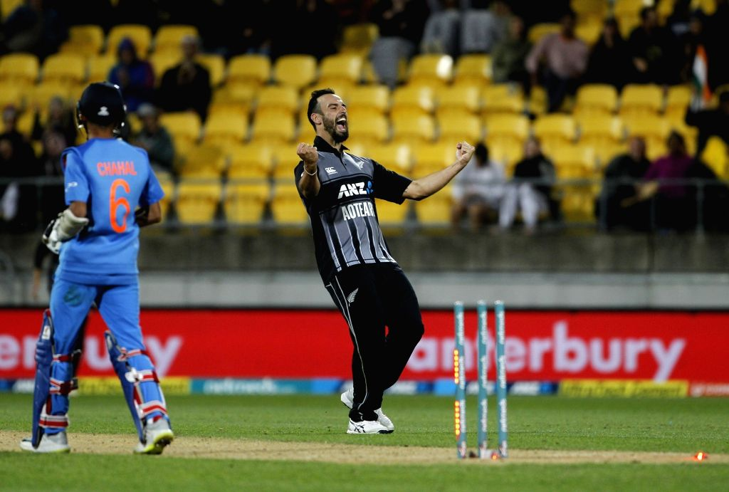 New Zealand's Daryl Mitchell celebrates fall of Yuzvendra Chahal's wicket during the first T20I match between India and New Zealand at Westpac Stadium in Wellington, New Zealand on Feb 6, ...