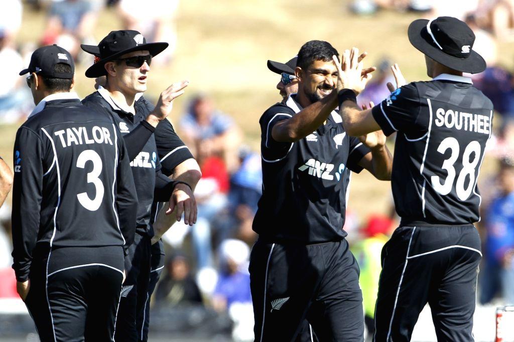 New Zealand's Ish Sodhi celebrates the wicket of Virat Kohli with teammates during the 1st ODI of the three-match series between India and New Zealand at the Seddon Park in Hamilton, New ... - Virat Kohli