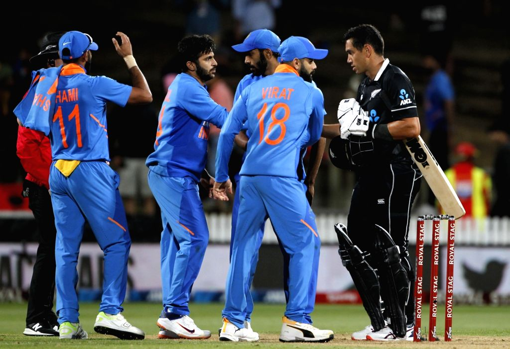 New Zealand's Ross Taylor being congratulated by India players after New Zealand won the 1st ODI of the three-match series by four wickets against India at the Seddon Park in Hamilton, New ...