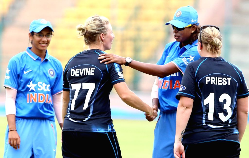 New Zealand women cricketer Sophie Devine shake hands with the Indian women cricketer Jhulan Goswami during 1st T20I match between India and New Zealand at Chinnasawamy Stadium, in ... - Jhulan Goswami