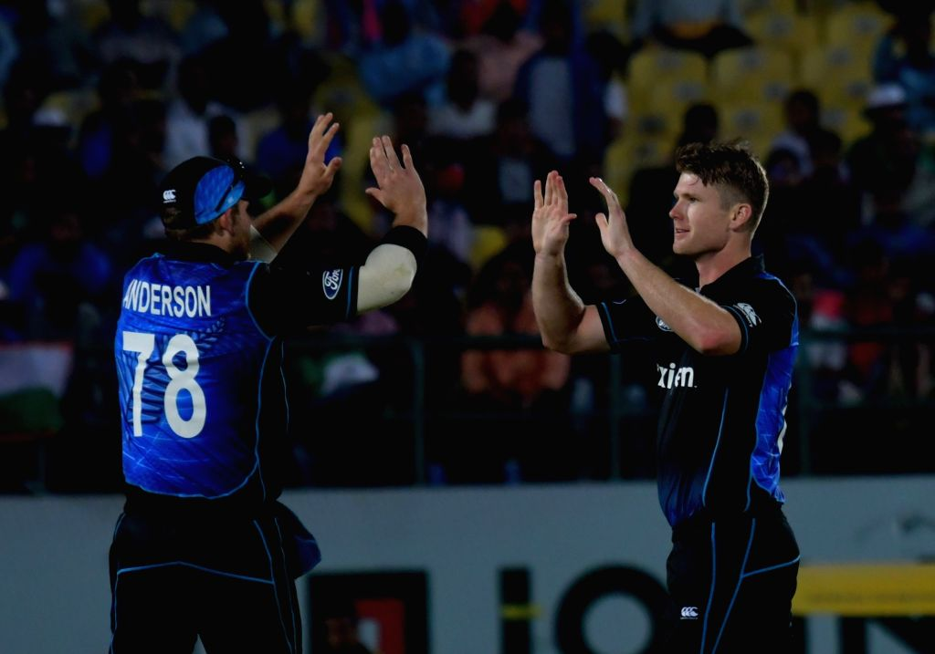New Zealanders celebrate fall of a wicket during the first One Day International match between India and New Zealand at Himachal Pradesh Cricket Association Stadium in Dharamsala on Oct ...