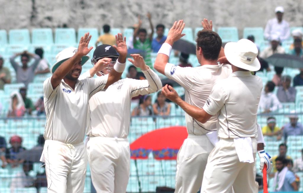 New Zealanders celebrate fall of a wicket on the third day of the Second Test Match between India and New Zealand at Eden Gardens in Kolkata on Oct 2, 2016.