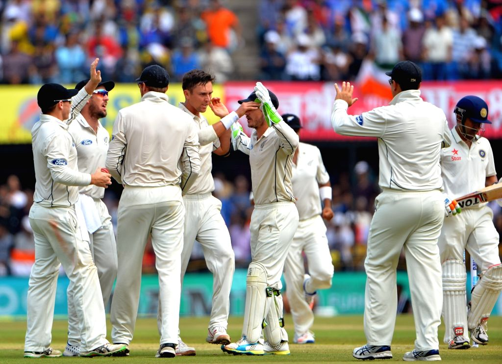 New Zealanders celebrate fall of a wicket on the first day of the third test match between India and New Zealand at Holkar stadium in Indore on Oct 8, 2016.