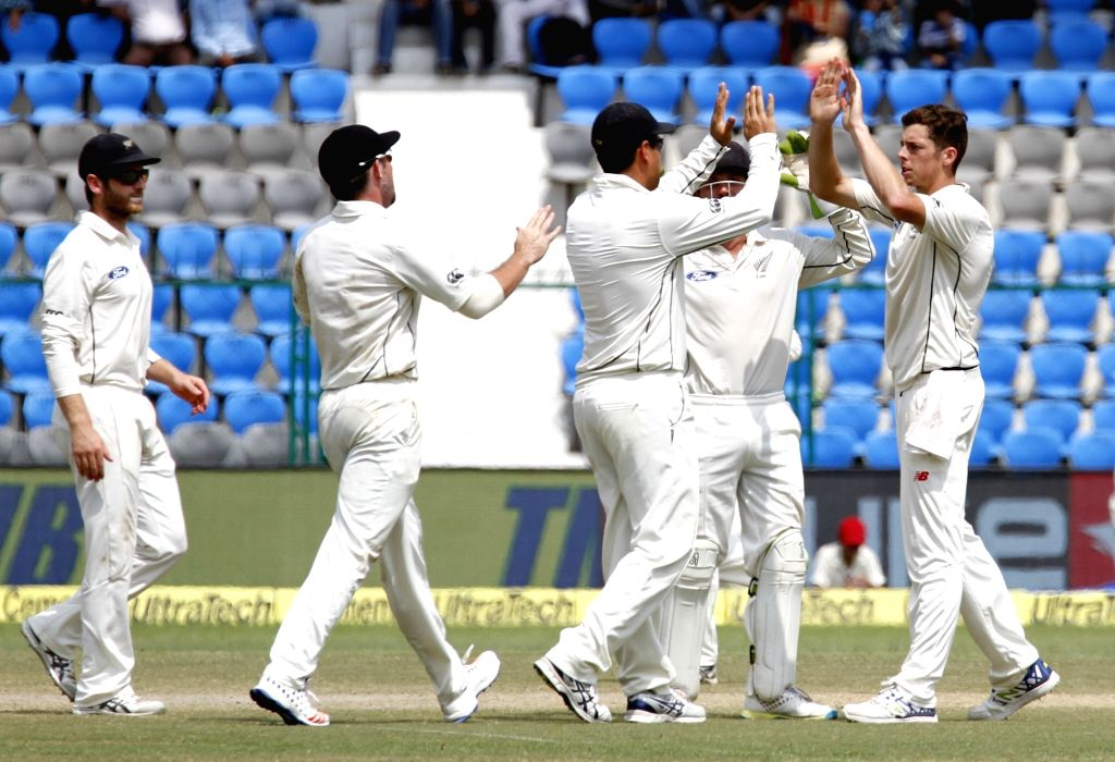 New Zealanders celebrate fall of Ajinkya Rahane's wicket on Day 4 of the 1st Test match between India and New Zealand at Green Park in Kanpur on Sept 25, 2016.
