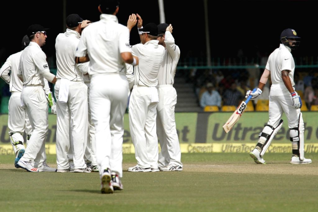 New Zealanders celebrate fall of Murali Vijay's wicket during Day 4 of the 1st Test match between India and New Zealand at Green Park in Kanpur on Sept 25, 2016.
