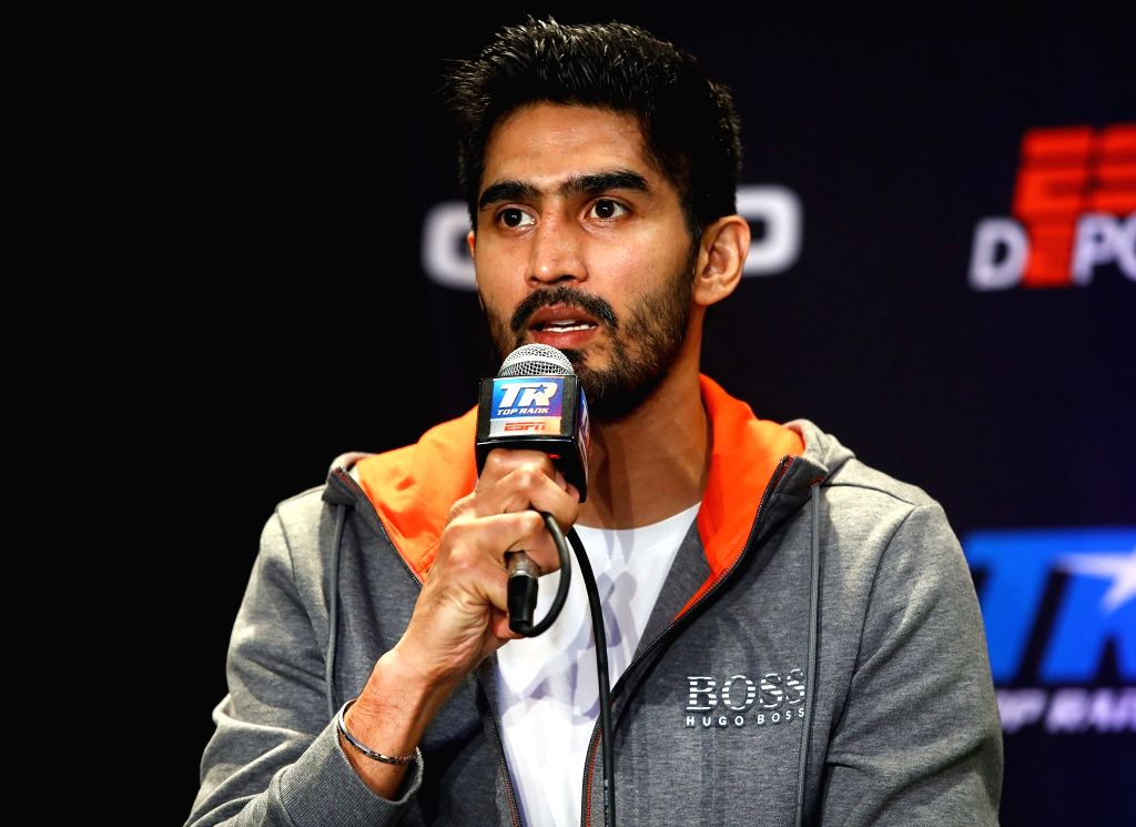 Newark: Boxer Vijender Singh addresses a press conference ahead of his US debut against American boxer Mike Snider in Newark, New Jersey, United States. (Photo: IANS) - Vijender Singh