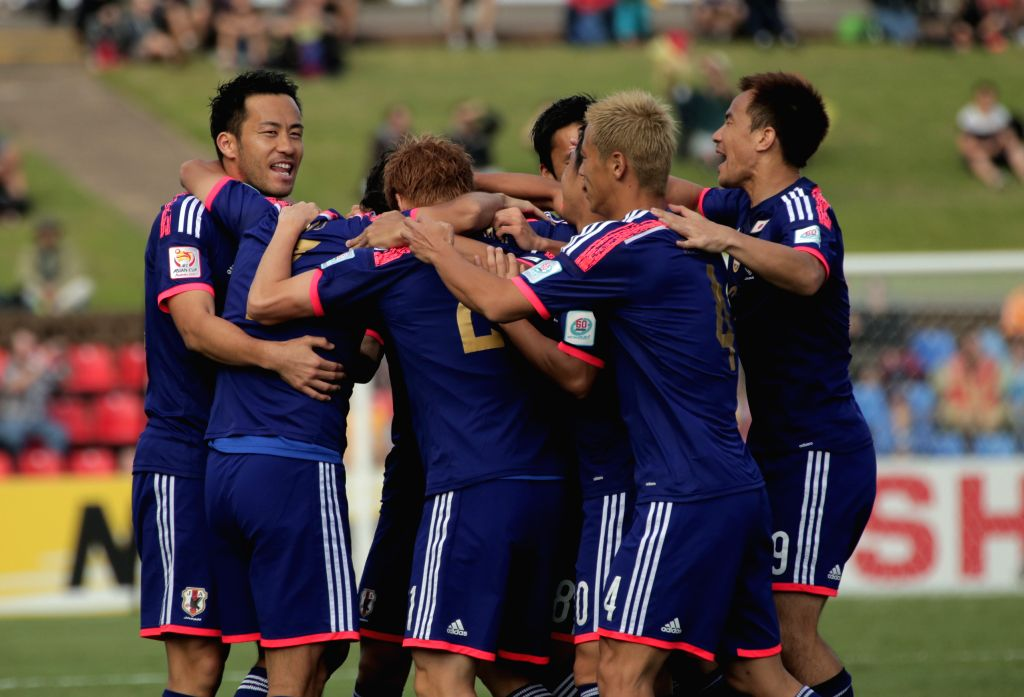 Team Japan celebrates victory after a Group D match against Palestine at the AFC Asian Cup in Newcastle, Australia, Jan. 12, 2015. Japan won 4-0. (Xinhua/Qiu ...