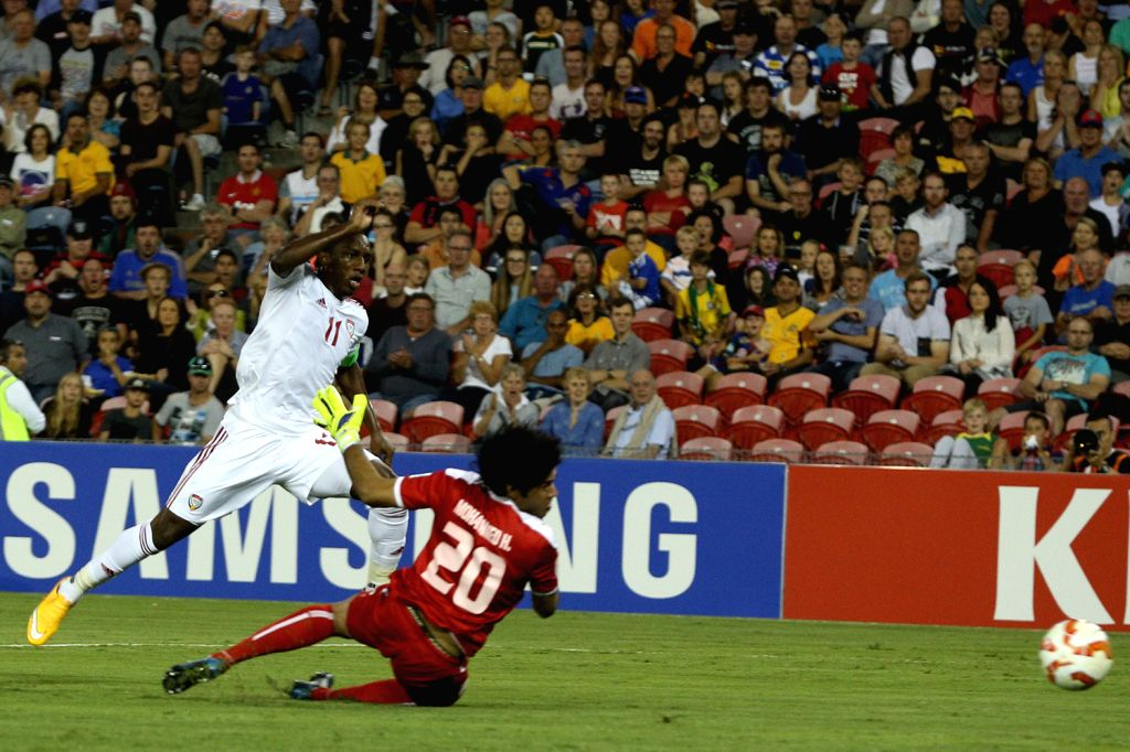 Ahmed Khalil (L) of the United Arab Emirates shoots his goal during the third and fourth final match against Iraq at the 2015 AFC Asian Cup in Newcastle, ...