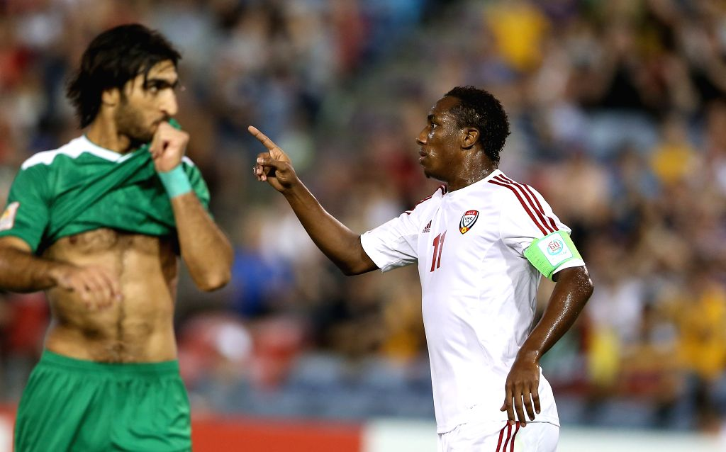 Ahmed Khalil (R) of the United Arab Emirates celebrates for his goal during the third and fourth final match against Iraq at the 2015 AFC Asian Cup in Newcastle, .