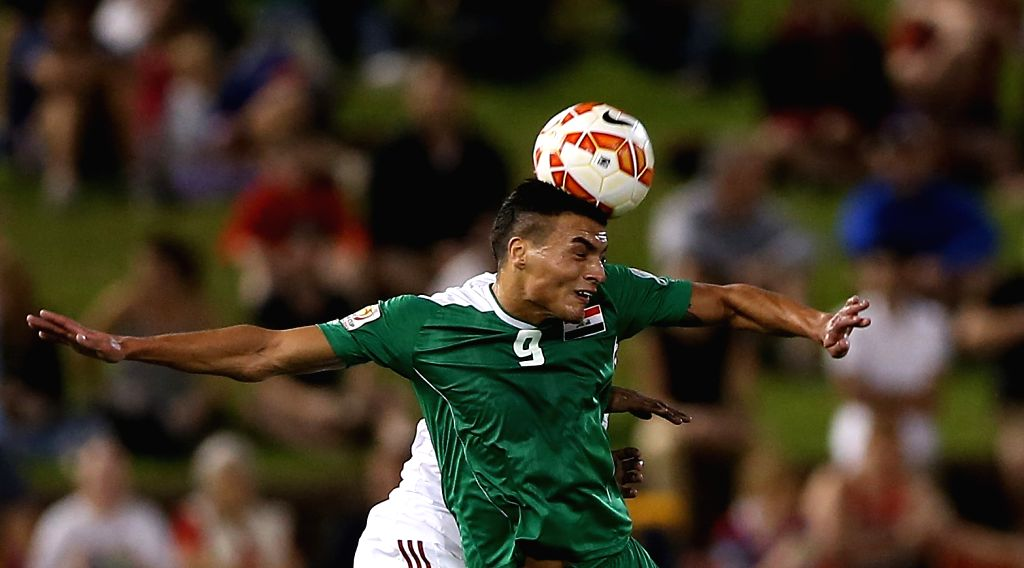Ahmed Yaseen Gheni of Iraq goes for a header during the third and fourth final match against the United Arab Emirates at the 2015 AFC Asian Cup in Newcastle, ...