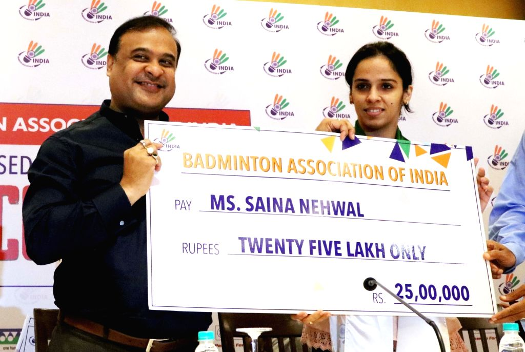 Newly-appointed Badminton Association of India president Dr. Himanta Biswa Sarma presents a cheque of Rs. twenty five lakh to Indian badminton player Saina Nehwal during a programme in New ...