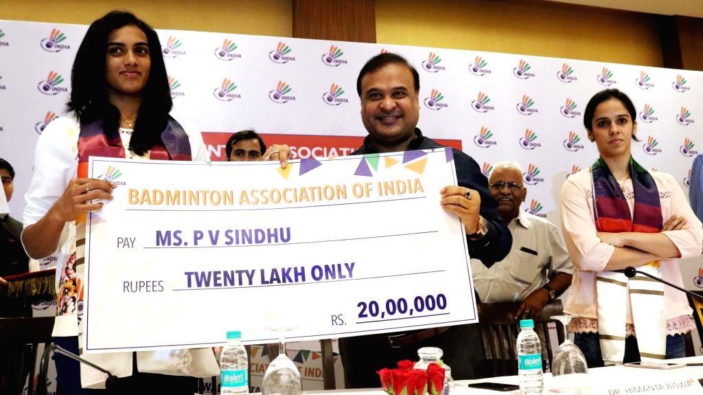 Newly-appointed Badminton Association of India president Dr. Himanta Biswa Sarma presents a cheque of Rs. twenty lakh to Indian badminton player PV Sindhu during a programme in New Delhi, ...