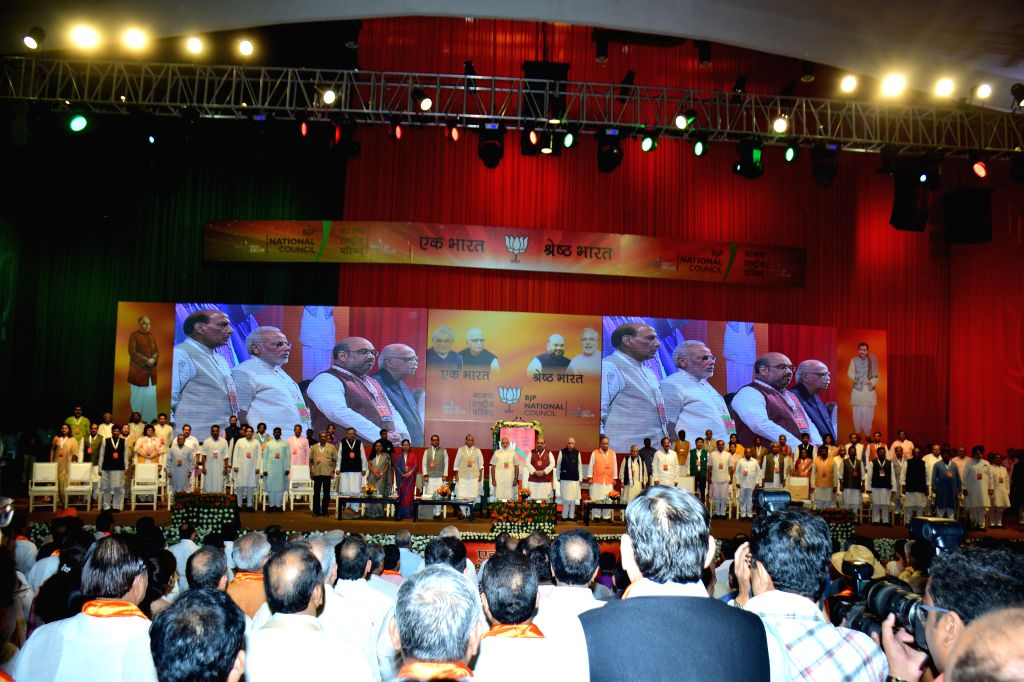 Newly appointed BJP President Amit Shah seeks blessings of senior party leaders during the BJP National Council meeting in New Delhi on Aug. 9, 2014.