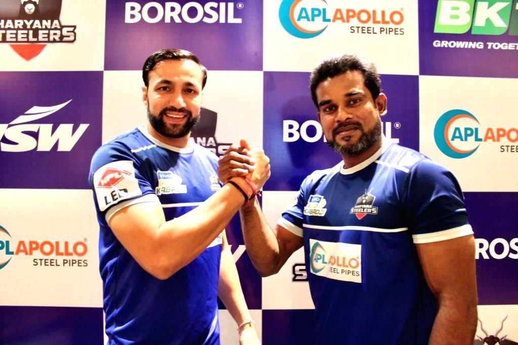 Newly appointed captain and head coach of Haryana Steelers - Dharmaraj Cheralathan and Rakesh Kumar respectively, at the launch of the team's new jersey for Pro Kabaddi League (PKL) Season ... - Rakesh Kumar