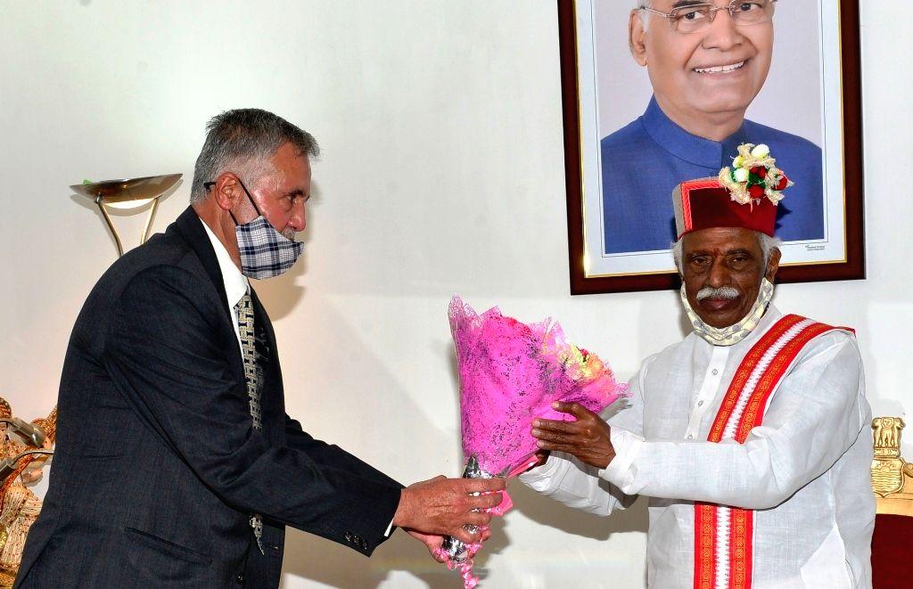 Newly appointed Chairman of Himachal Pradesh Public Service Commission Ajay Kumar and Member Jai Prakash Kalta called on Governor Bandaru Dattatraya at Raj Bhavan on Saturday March 27, 2021.