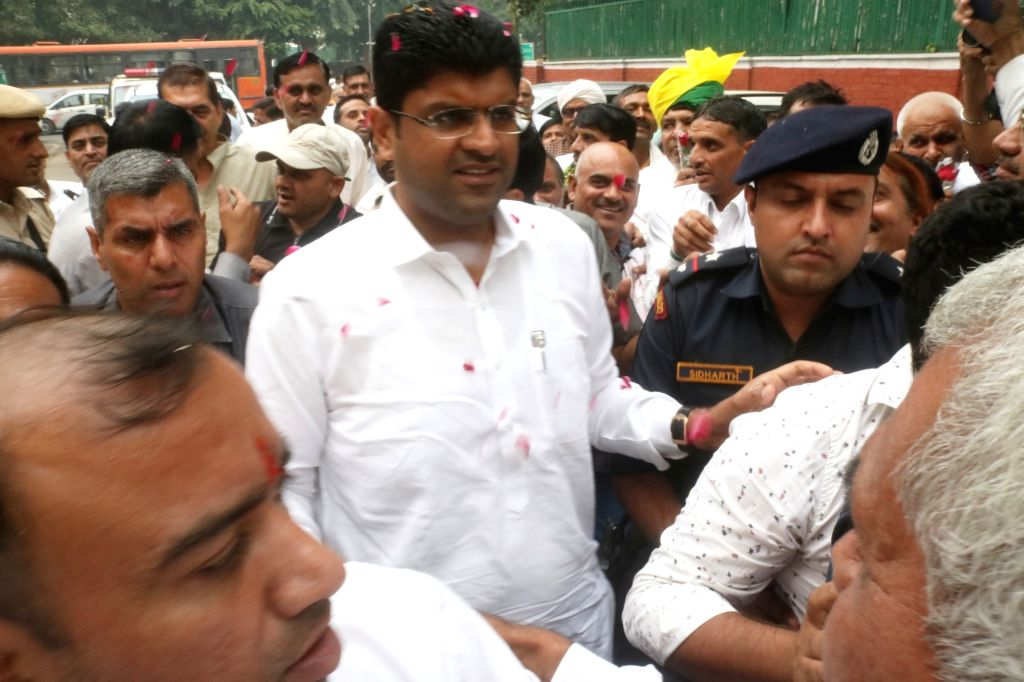 Newly appointed Haryana Deputy Chief Minister and Jannayak Janta Party (JJP) chief Dushyant Chautala receives warm welcome from party workers on his arrival in New Delhi on Oct 29, 2019.