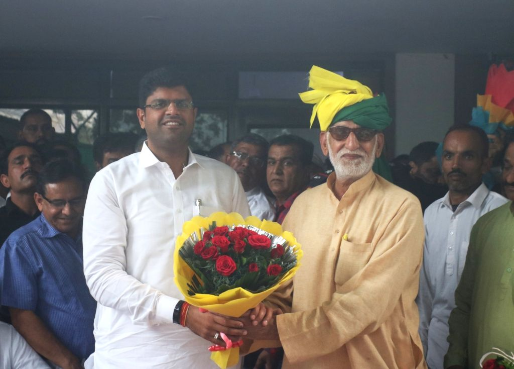 Newly appointed Haryana Deputy Chief Minister and Jannayak Janta Party (JJP) chief Dushyant Chautala receives warm welcome from party workers on his arrival in New Delhi for the state's ...