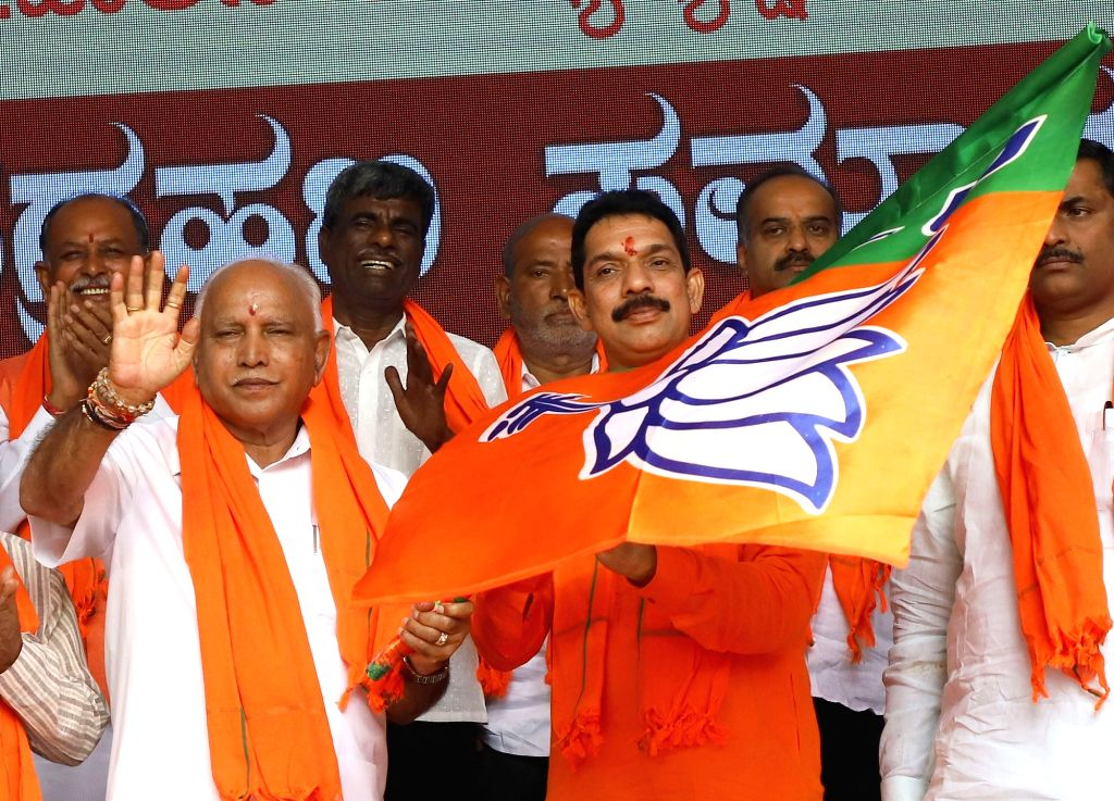 Newly appointed Karnataka BJP President Nalin Kumar Kateel accompanied by State Chief Minister BS Yediyurappa during his felicitation programme at party office in Bengaluru on Aug 27, 2019. - B and Nalin Kumar Kateel