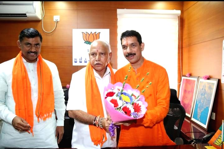 Newly appointed Karnataka BJP President Naveen Kumar Kateel takes charge from Chief Minister BS Yeddyurappa at party office in Bengaluru on Aug 27, 2019. - B and Naveen Kumar Kateel