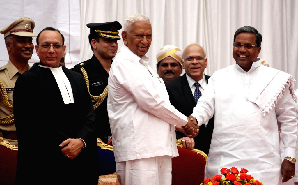 Newly appointed Karnataka Governor Vajubhai Rudabhai Vala with Karnataka Chief Minister Siddaramaiah and Chief Justice of Karnataka High Court  D H Waghela during former's swearing-in ceremony as the - Siddaramaiah
