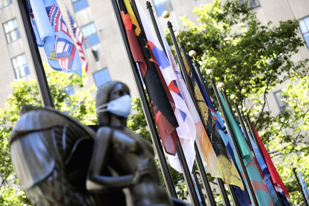 Newly-designed flags are seen around the rink of the Rockefeller Center in New York, the United States, August 1, 2020. The Flag Project, an art exhibition ...