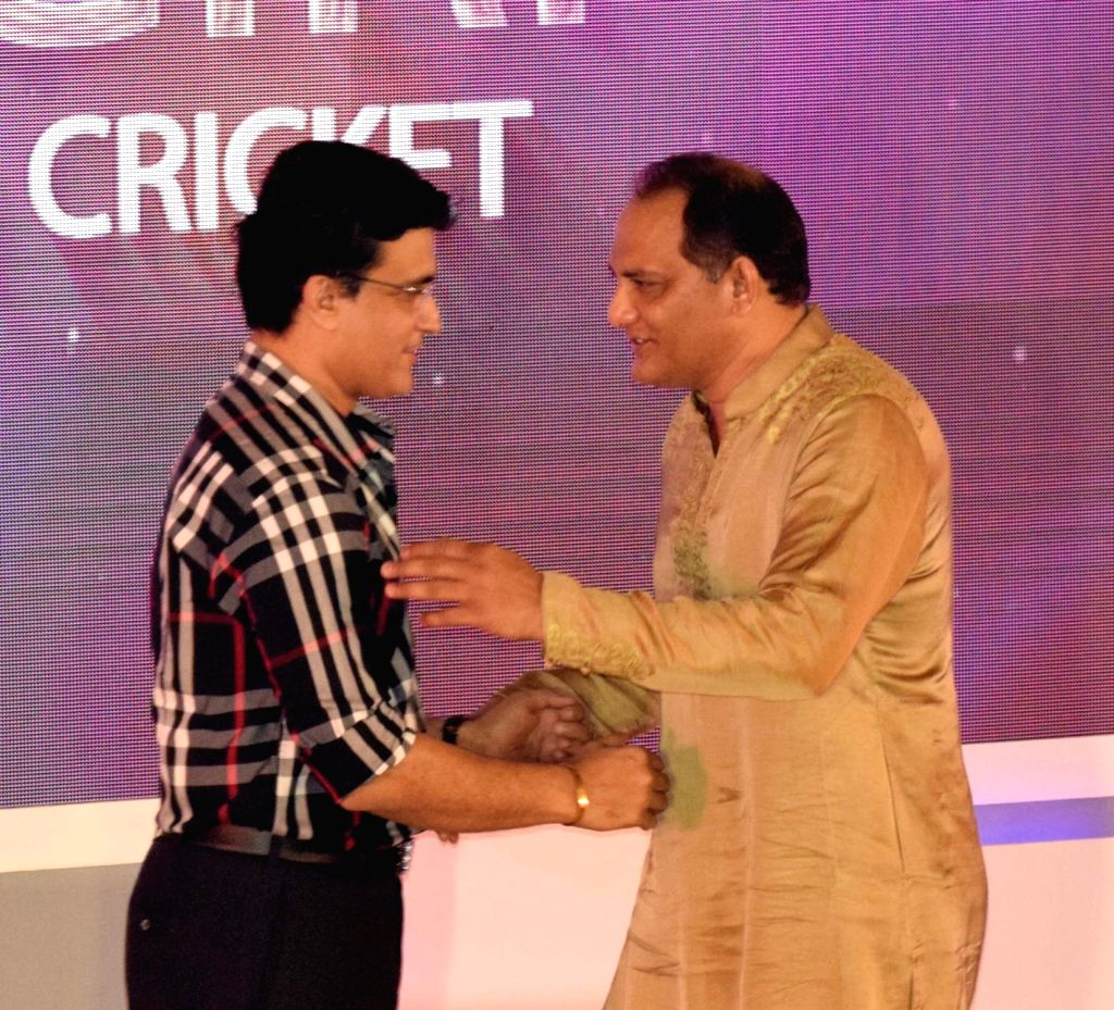 Newly-elected BCCI president Sourav Ganguly and former India cricketer Mohammed Azharuddin during a felicitation programme organised by Cricket Association of Bengal (CAB) in Kolkata on Oct ... - Sourav Ganguly and Azharuddin