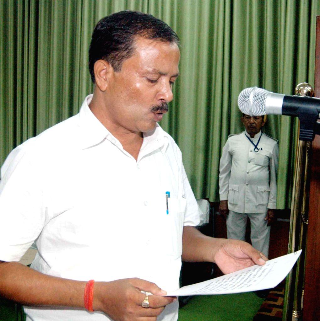 Newly elected BJP legislator Awadesh Singh takes oath of office in Patna on Sept 4, 2014. - Awadesh Singh