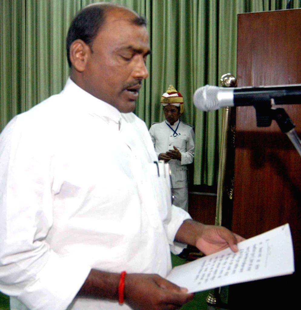Newly elected BJP legislator Niranjan Ram takes oath of office in Patna on Sept 4, 2014.