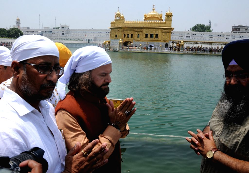 Newly elected BJP MP from North West Delhi, Hans Raj Hans pays obeisance at the Golden Temple in Amritsar, on June 3, 2019.