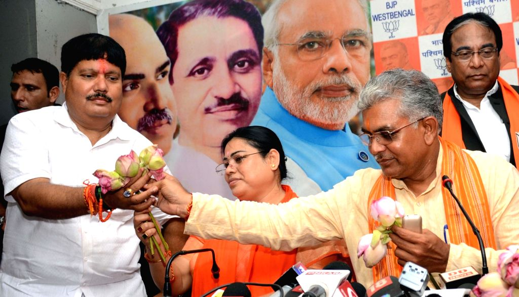 Newly elected BJP MPs Arjun Singh (Barrackpore), Debashree Chowdhury (North Dinajpur) and Dilip Ghosh (Midnapore) during a felicitation programme at the state party headquarters in Kolkata, ... - Arjun Singh and Dilip Ghosh