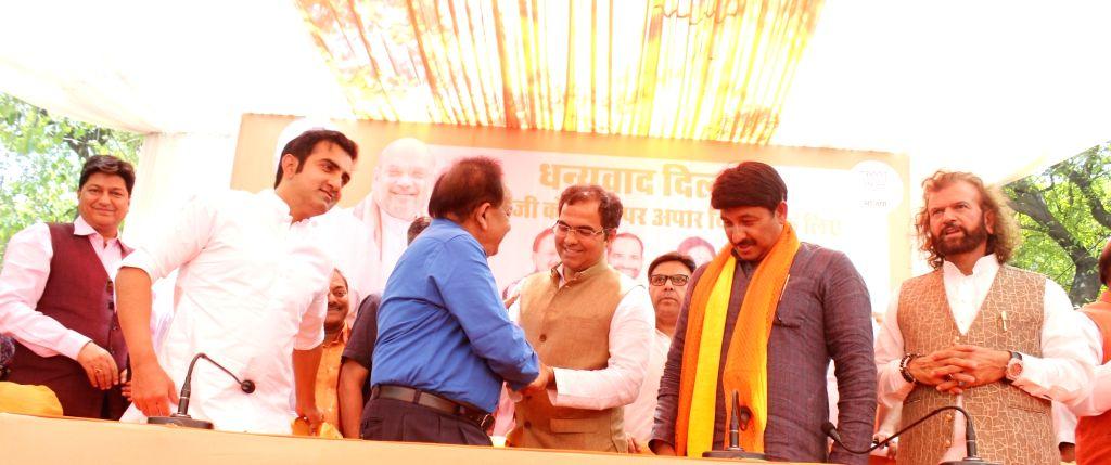 Newly elected BJP MPs from Delhi - Gautam Gambhir (East Delhi), Harsh Vardhan (Chandni Chowk), Parvesh Verma (West Delhi), Manoj Tiwari (North East Delhi) and Hans Raj Hans (North West Delhi) during ... - Parvesh Verma