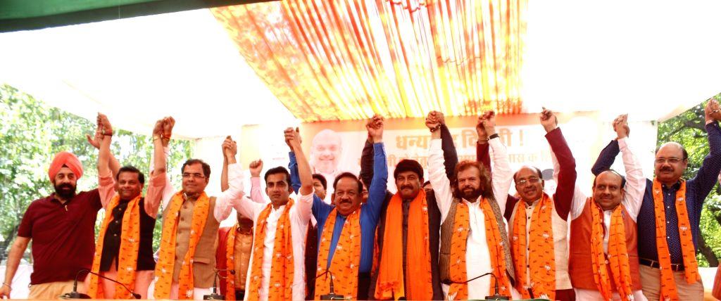 Newly elected BJP MPs from Delhi - Parvesh Verma (West Delhi), Gautam Gambhir (East Delhi), Harsh Vardhan (Chandni Chowk), Manoj Tiwari (North East Delhi) and Hans Raj Hans (North West ... - Vijay Goel, Parvesh Verma and Vijender Gupta