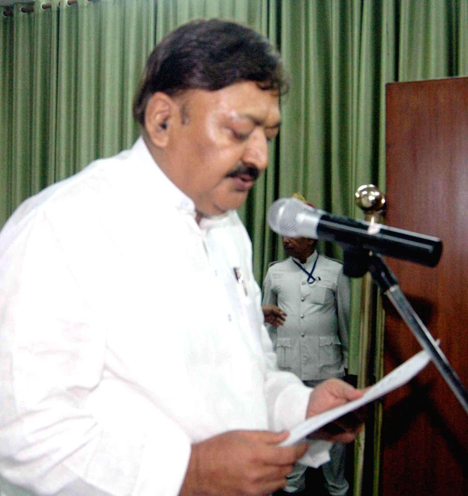 Newly elected Congress legislator Ajit Sharma takes oath of office in Patna on Sept 4, 2014. - Ajit Sharma