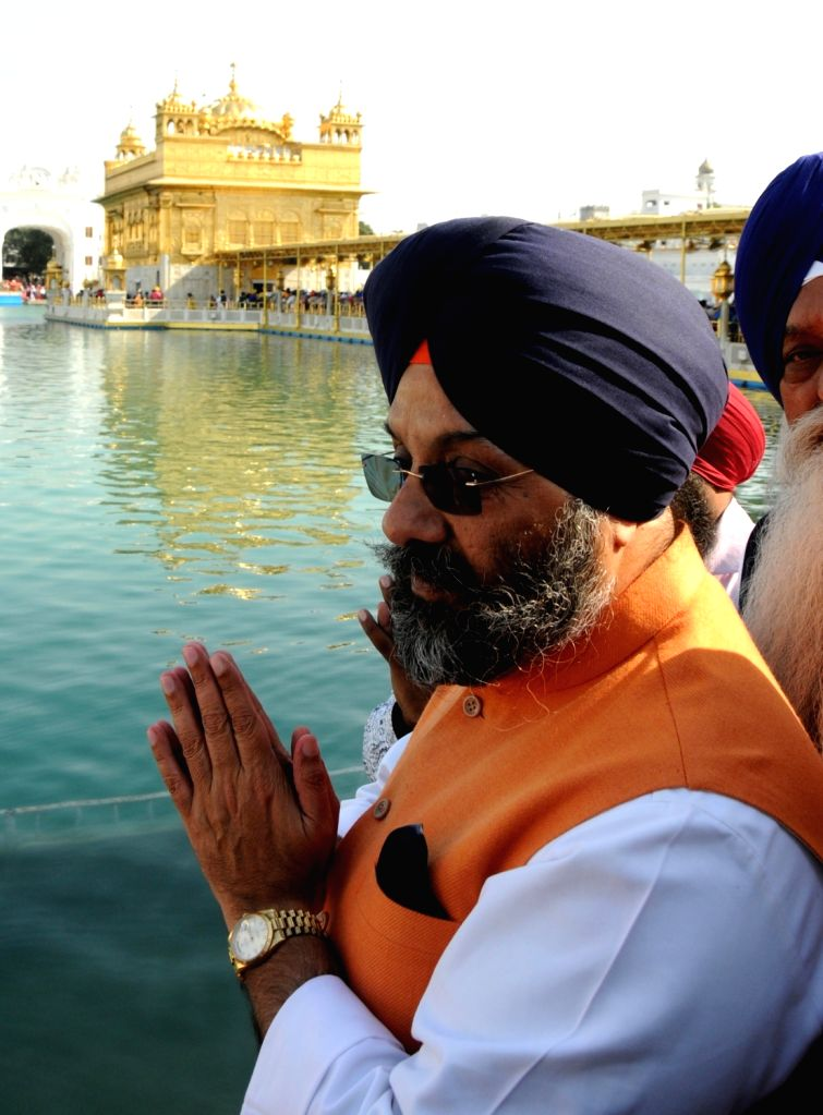 Newly-elected Delhi Sikh Gurdwara Management Committee (DSGMC) president Manjit Singh G K pays obeisance at the Golden Temple in Amritsar, on March 6, 2017.