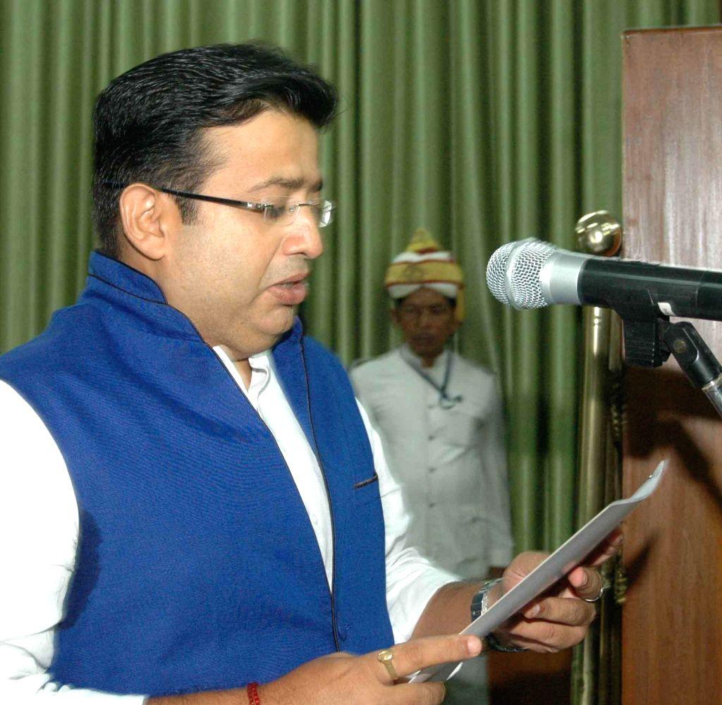 Newly elected JD (U) legislator Rishi Mishra takes oath of office in Patna on Sept 4, 2014. - Rishi Mishra