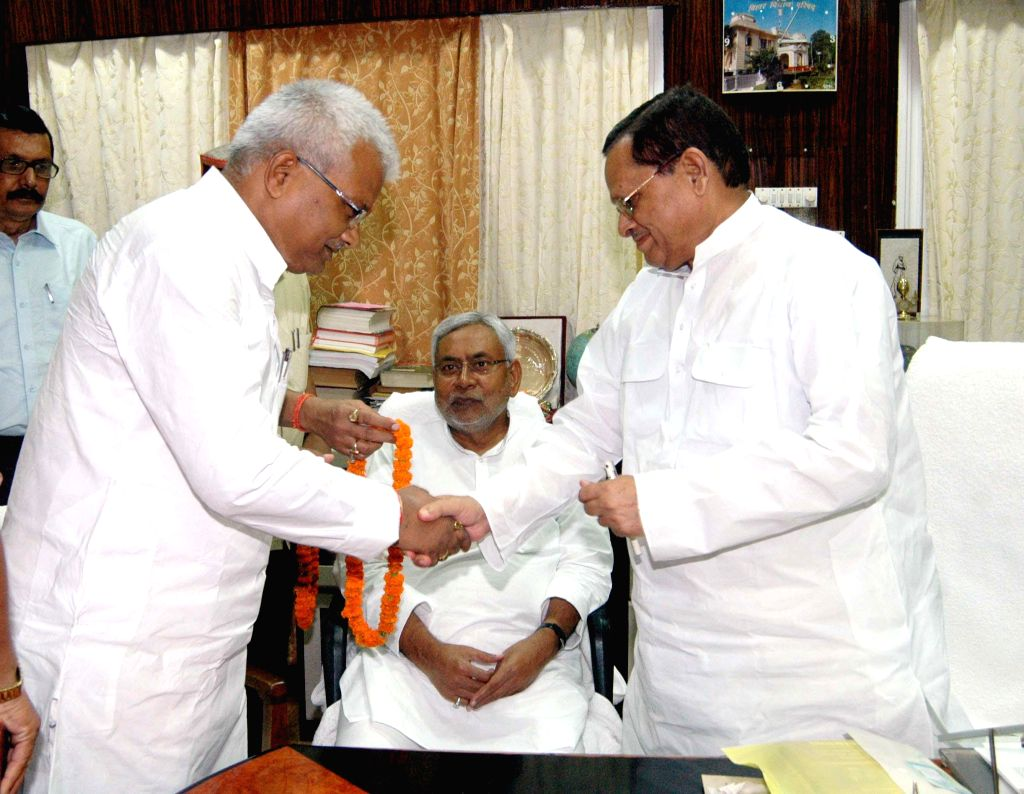 Newly elected MLAs take oath of office in front of former Bihar Chief Minister Nitish Kumar in Patna on Sept. 6, 2014.