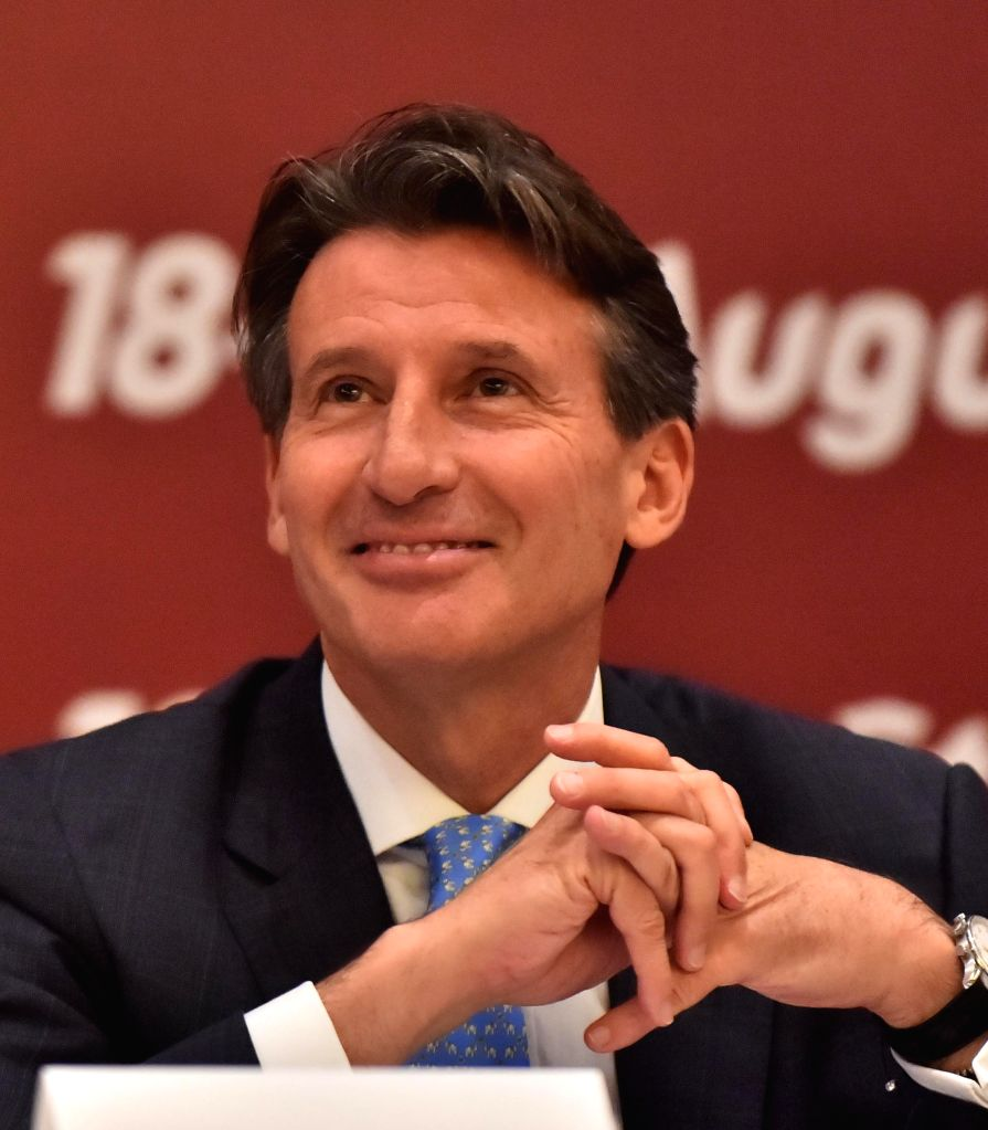 Newly elected President of the International Association of Athletics Federations (IAAF), Britain's Sebastian Coe reacts during a press conference in Beijing, ...
